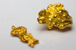 Close-up of two gold-nuggets