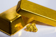 Close-up of fine gold ingots and a gold-nugget - 50209078
