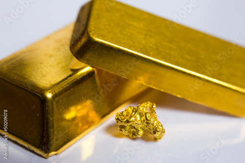 Close-up of fine gold ingots and a gold-nugget