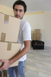 Man carrying boxes during house move