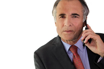 Businessman using a cellphone in the office