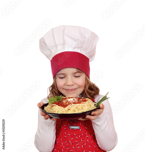 little girl cook enjoys spaghetti