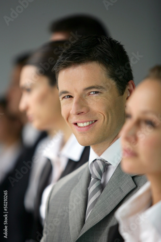 Businesspeople stood in a row