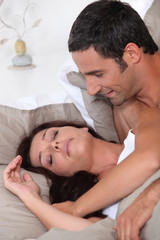 Married couple laying in bed