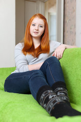 red-haired girl in home interior