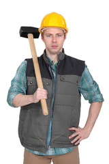 Builder stood with sledge-hammer