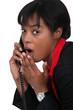 black businesswoman on the phone  shocked at sensational news