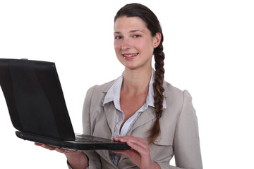 Businesswoman standing with her laptop.
