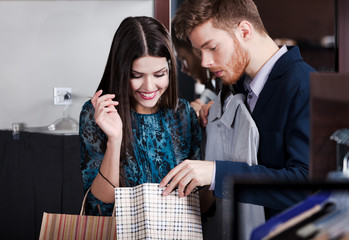 Man looks into the packet with purchases of his girlfriend
