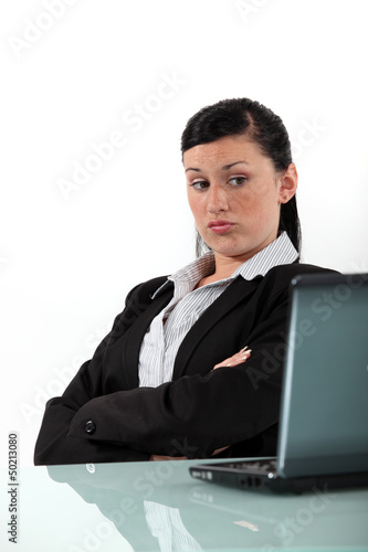 bored businesswoman looking at her laptop