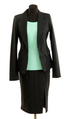 Turquoise blouse and black skirt with coat