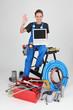woman plumber showing laptop doing OK sign