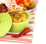 Delicious pilaf with vegetables isolated on white