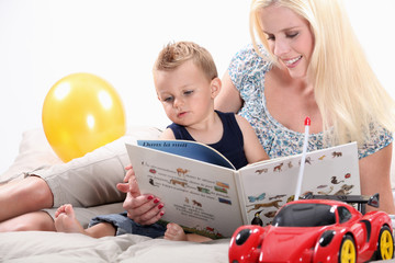 Woman reading a book to her son