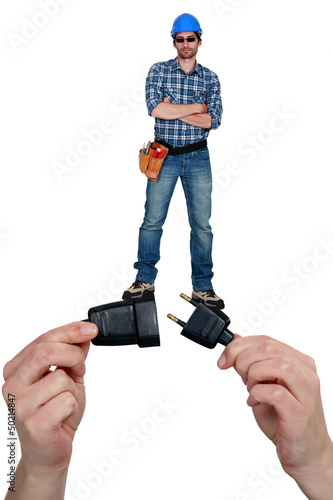 Cool electrician standing on a plug