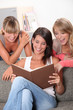 Women looking at book