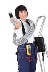 Tradeswoman holding a mobile phone