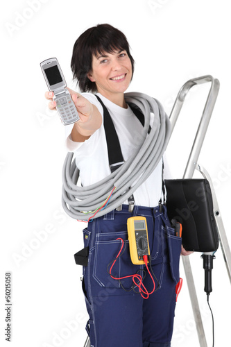 Tradeswoman holding a mobile phone