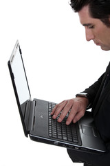 Office worker holding laptop