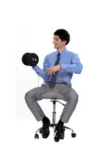 Businessman lifting weights