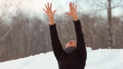 A woman doing yoga in the winter woods