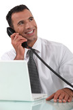 Office worker talking on the telephone