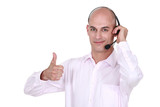 Man wearing headphones giving the thumb's up