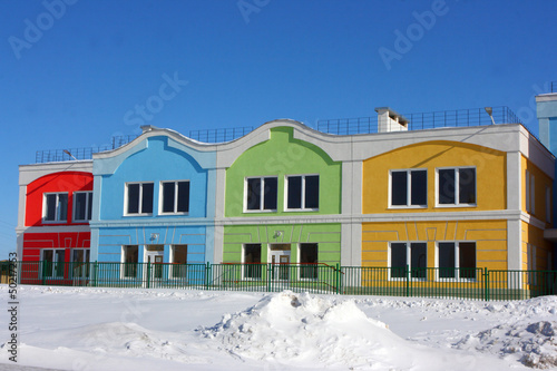 Modern colorful houses against a blue sky in the winter