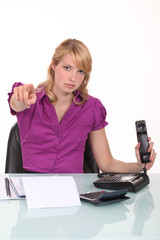 Angry office worker pointing finger to camera