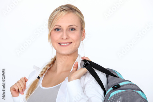 Blond woman with gym bag