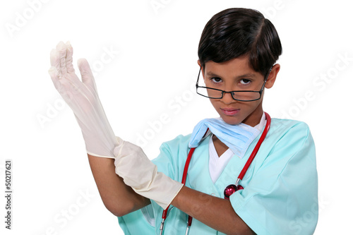 Boy dressed as surgeon
