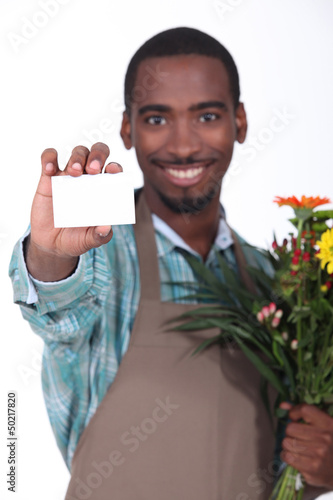 Male florist with business card