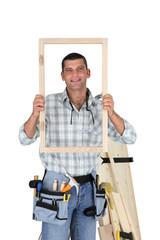 Carpenter showing wood frame