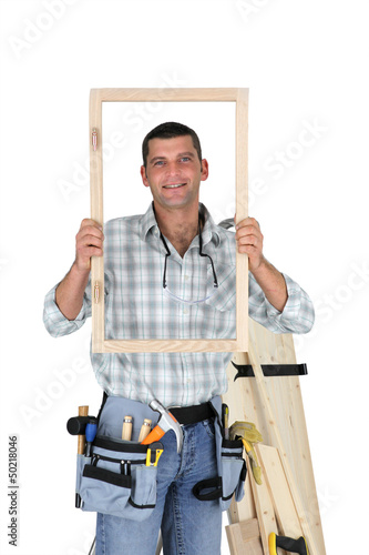 Carpenter showing wood frame