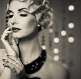Monochrome picture of elegant blond retro woman