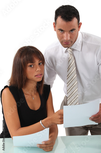 Business couple discussing paperwork