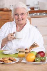 Senior woman having a relaxed breakfast