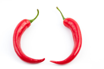 two chilies facing