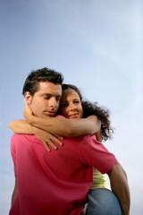 Man giving girlfriend piggy-back