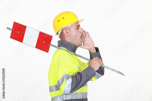 A road worker shouting instructions.