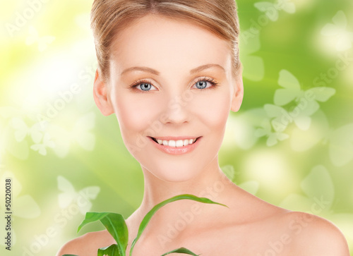 woman with sprout and butterflies