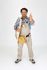 Male woodworker carrying frame