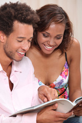Couple excitedly looking at a catalogue