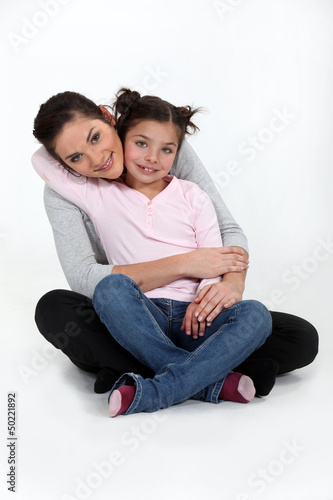 A mother and her daughter hugging.