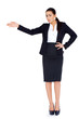 Business woman standing and pointing at copy space