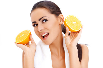 Woman with fresh orange halfs in her hands
