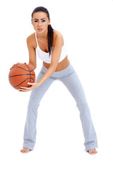 Woman standing and holding basketball
