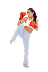 Full body shot of female kick boxer