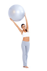 Woman doing exercises with fitness ball