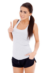 Sporty woman showing thumb up gesture